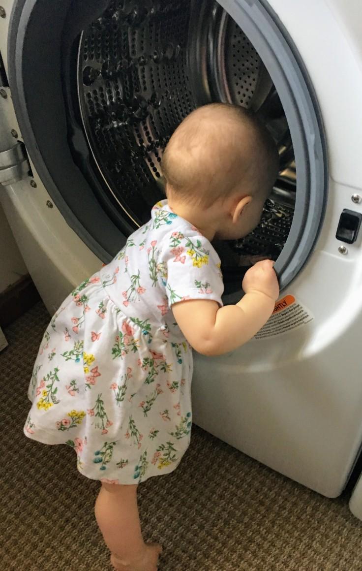 Baby doing laundry.JPG