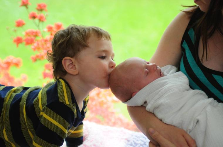 big brother kissing little sister