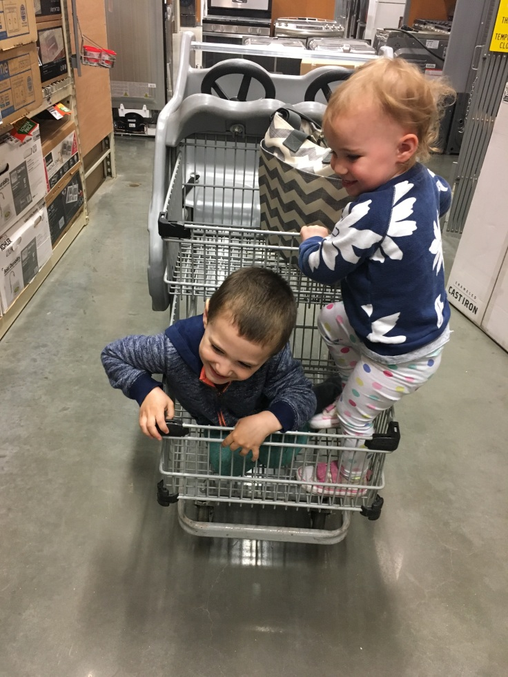 Kat and Reece try to cramp into the cart