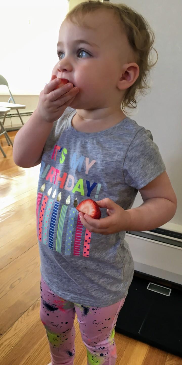 Kat nomming on strawberries