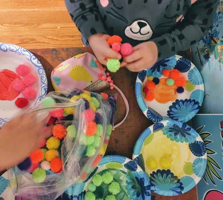 Sensory play organizing poms.