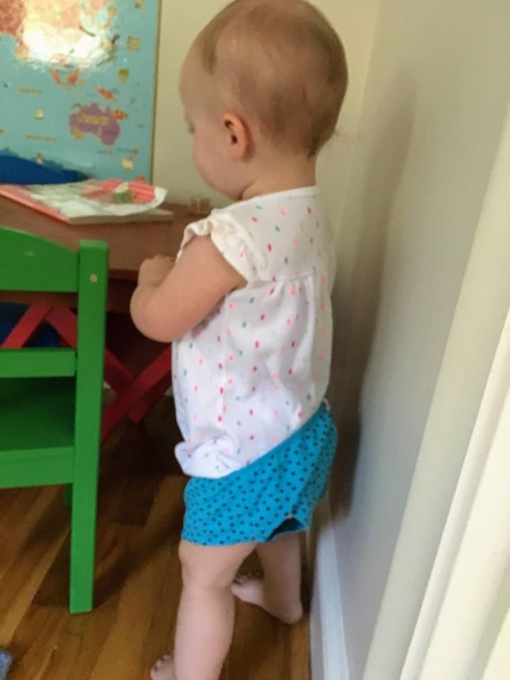 Toddler in underwear over onsie