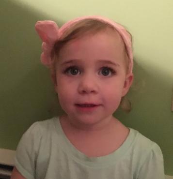 Kat wearing a headband