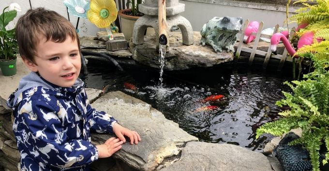Reece by Koi pond on April vacation