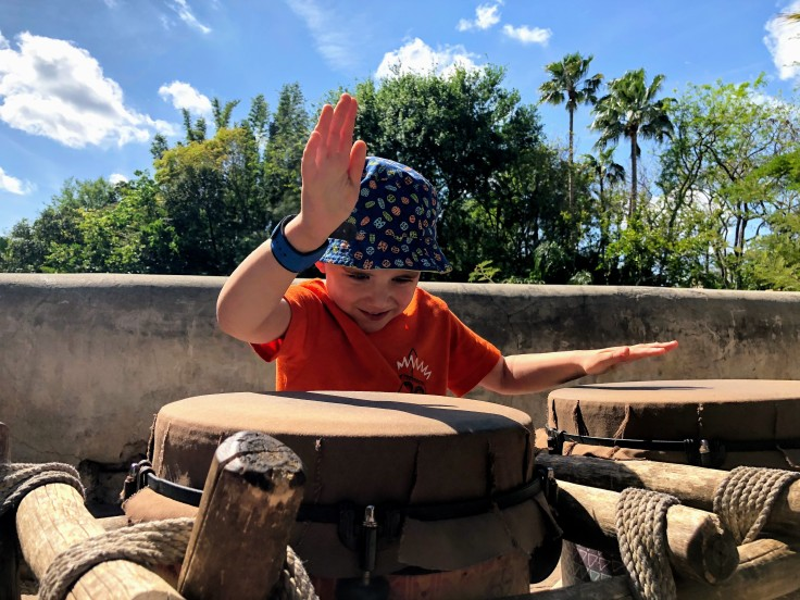 Reece keeping a beat, hitting the drums at Animal Kingdom