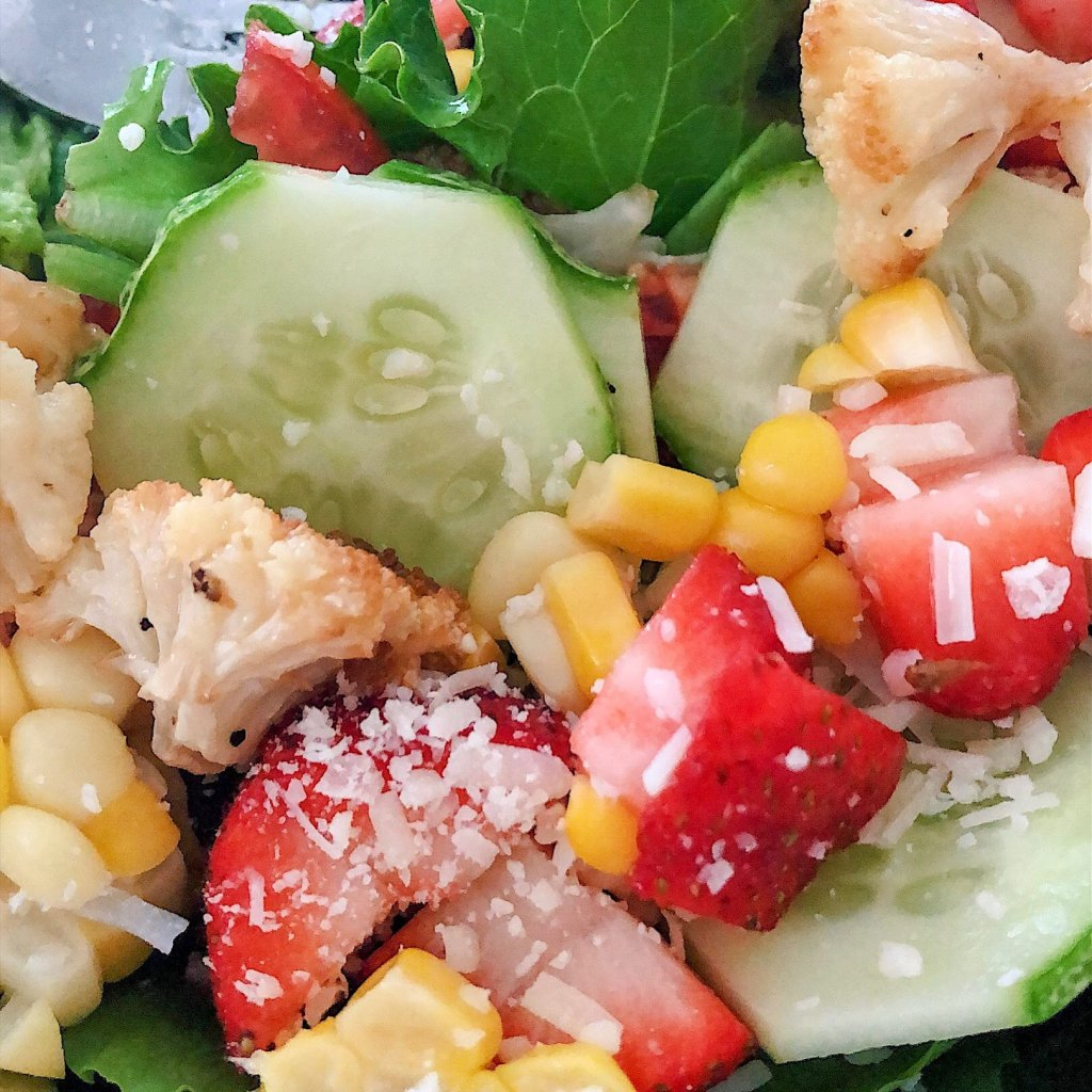 Cucumber, corn, cauliflower, strawberry summer salad