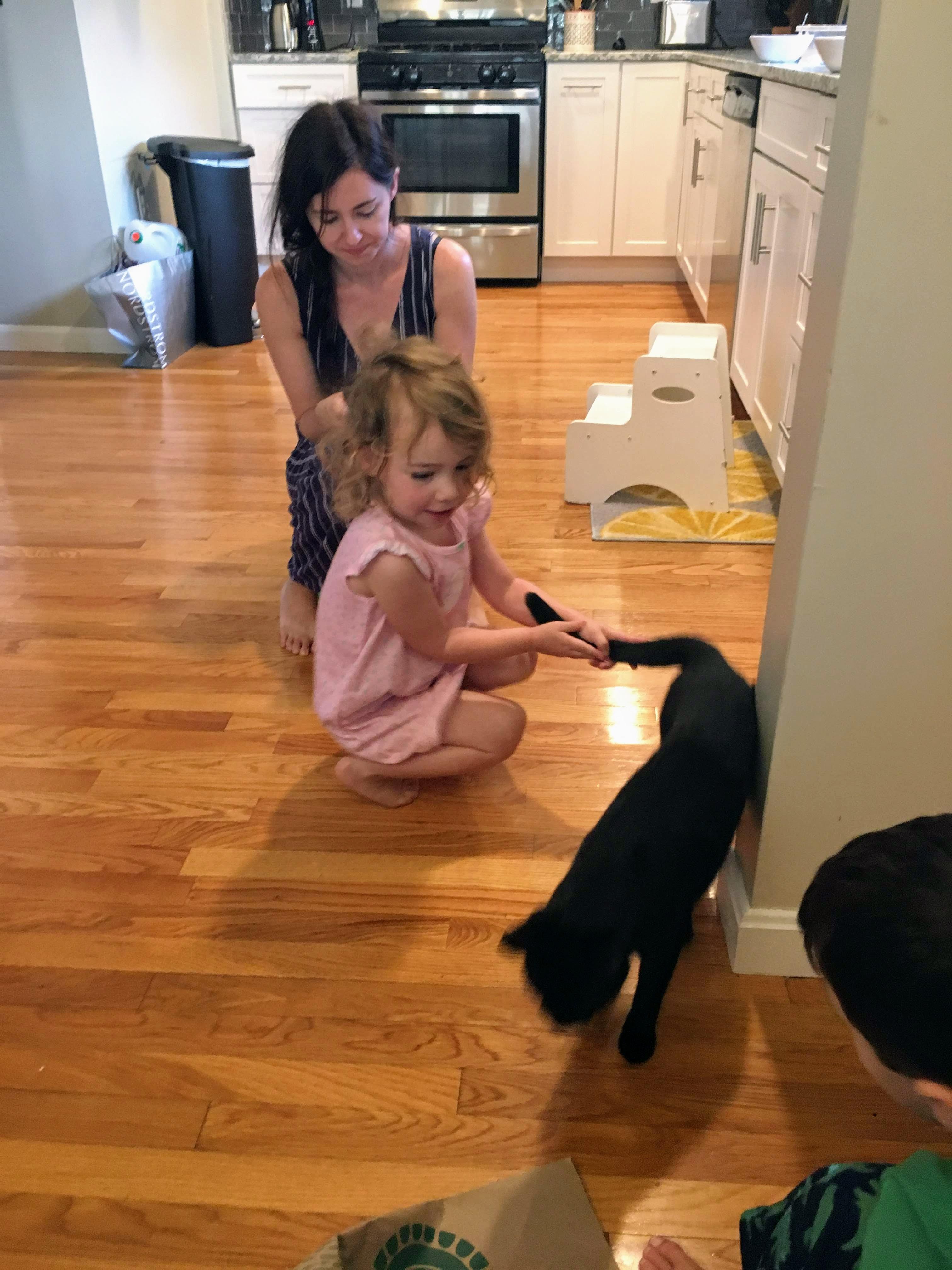 brushing Kat's hair while she pulls cat tail