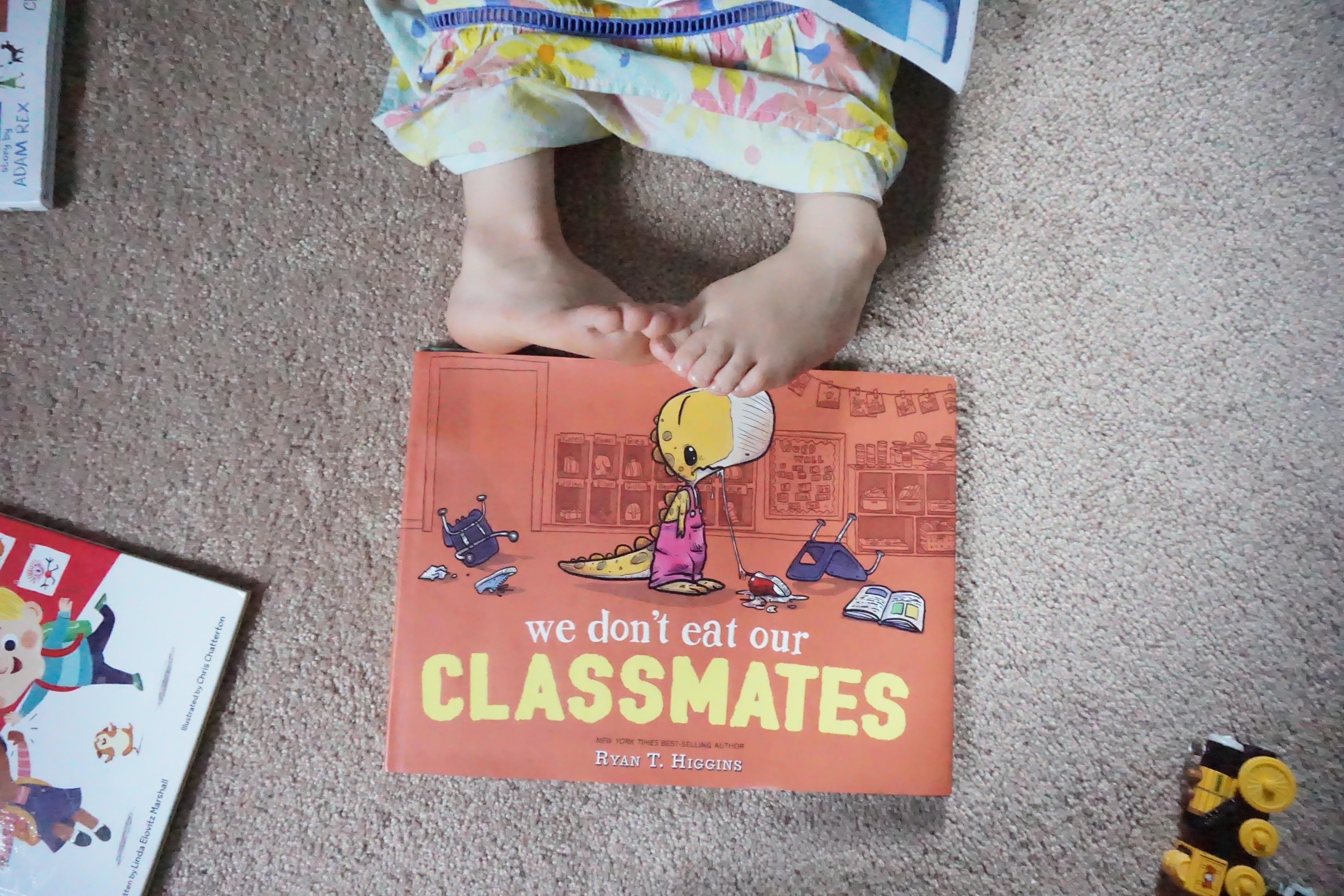 We Don't Eat Our Classmates book w/ toddler toes